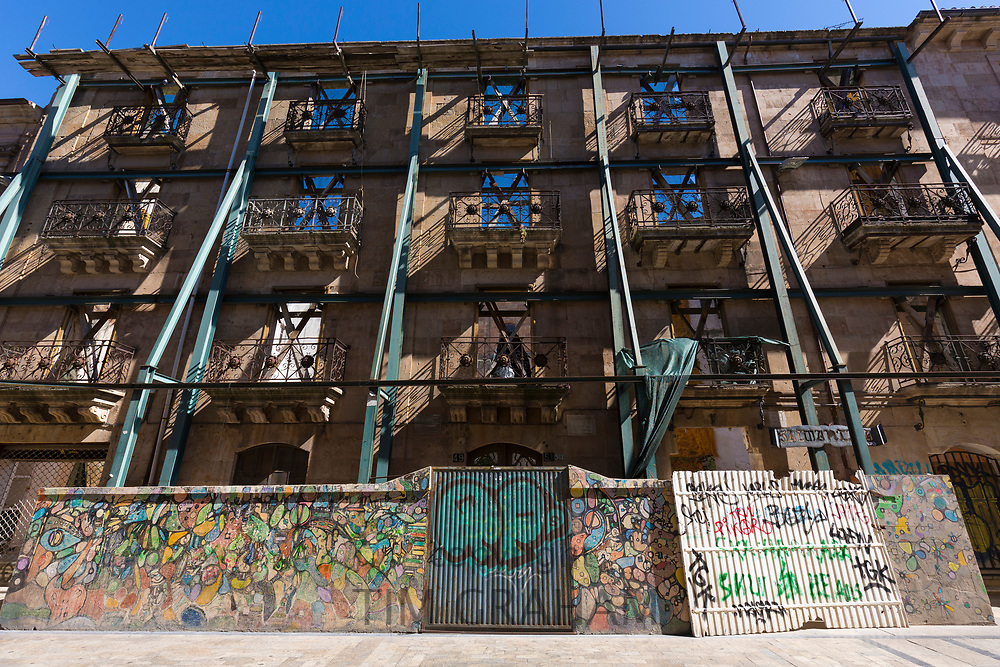 Protected facade frontage in Rua Mayor redevelopment construction of ancient building economic growth, Salamanca, Spain