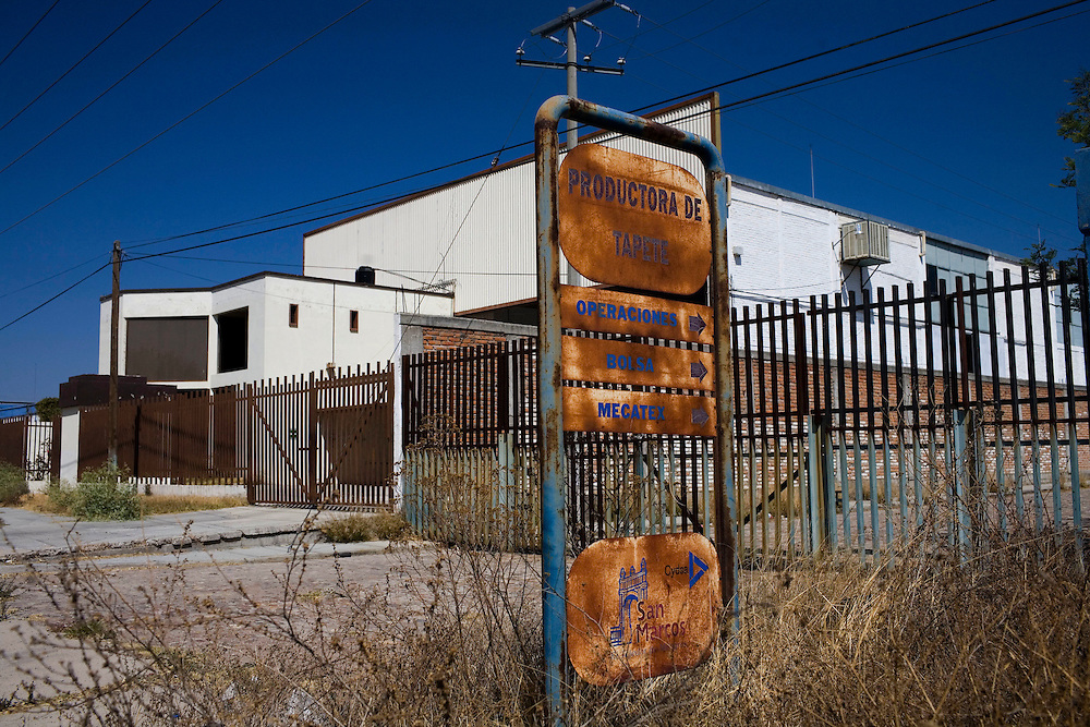 A closed textile factory in the industrial area of Aguascalientes, Mexico on Monday , March 17, 2009.  This factory has been closed for a few years and remains as a reminder of the steady decrease in jobs in the city.