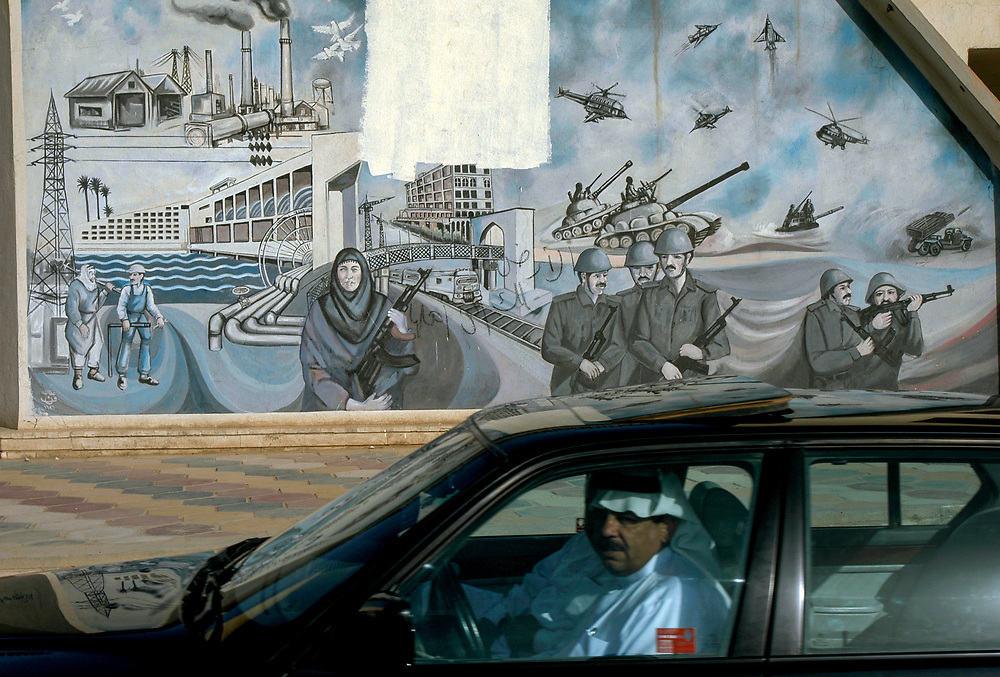 A mural from the Saddam era on the wall of a city street in the predominantly Sunni town of al-Ramadi. The Sheiks of the powerful tribal families are playing an important role in Sunni areas after the collapse of the once all powerful Ba'ath party.<br /> Ramadi, Iraq. 16/05/2003.