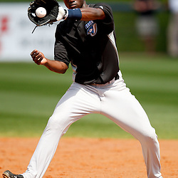 March 8, 2011; Port Charlotte, FL, USA; Toronto Blue Jays shortstop Adeiny Hechavarria (3) takes infield practice before a spring training exhibition game against the Tampa Bay Rays at Charlotte Sports Park.   Mandatory Credit: Derick E. Hingle