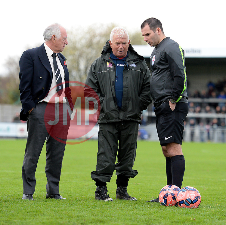 Referee Tim Robinson talks with Weston Super Mare Groundsman. - Photo mandatory by-line: Alex James/JMP - Mobile: 07966 386802 - 08/11/2014 - SPORT - Football - Weston-super-Mare - Woodspring Stadium - Weston-super-Mare v Doncaster - FA Cup - Round One