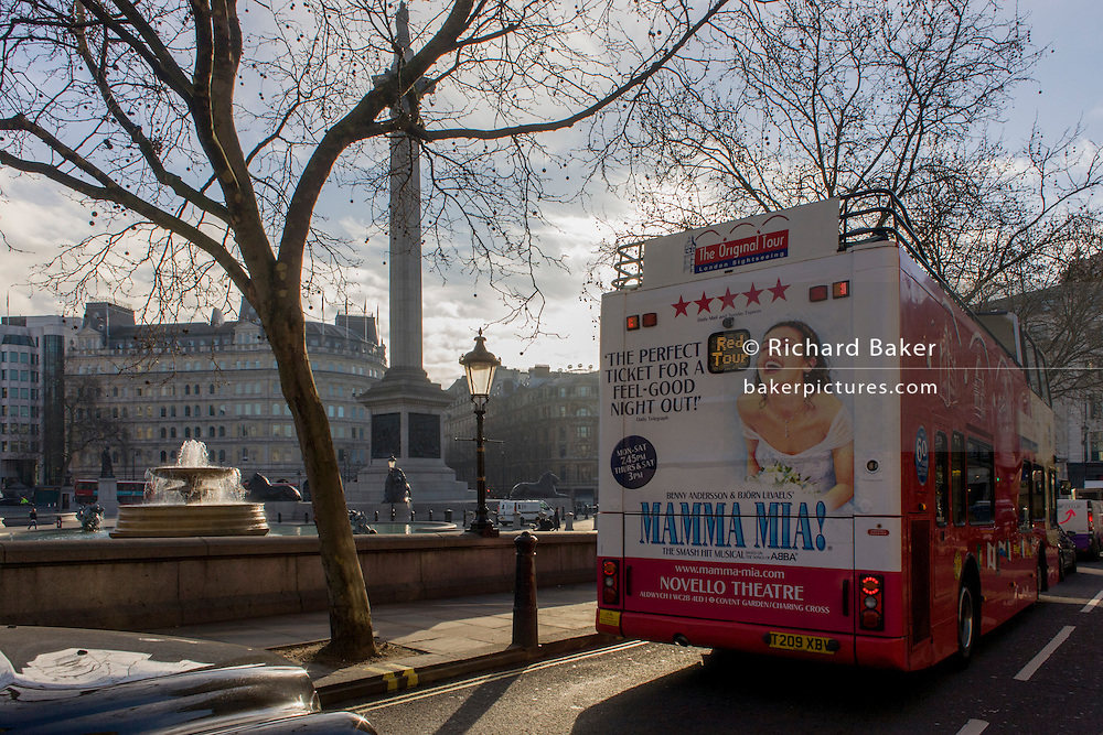 Bus rear advertising for Abba's West End musical Mamma Mia as it drives around Trafalgar Square and central London streets.