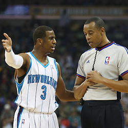 18 February 2009: New Orleans Hornets guard Chris Paul (3) talks with NBA official Rodney Mott during a NBA basketball game between the Orlando Magic and the New Orleans Hornets at the New Orleans Arena in New Orleans, Louisiana.