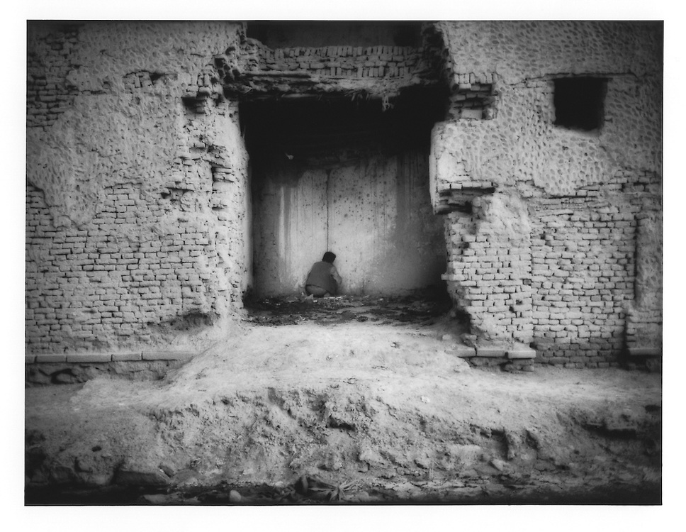Lone heroin user smokes in abandoned chamber in old city of Kabul, Afghanistan.  There are 40,000 - 50,000 heroin and opium users in Kabul, says Dr. Qureshi, Deputy Director of  Kabul's only gov?t run mental hospital, Psychiatric and Drug Dependency Hospital, Kabul.
