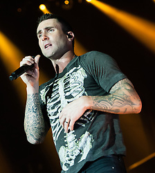 © Licensed to London News Pictures. 26/05/2015. London, UK.   Maroon 5 performing live at Wembley Arena.  In this picture - Adam Levine.  Maroon 5 is an American pop rock band composed of members Adam Levine (lead vocals, lead and rhythm guitar),  Jesse Carmichael (keyboards, rhythm guitar),  Mickey Madden ( bass),  James Valentine (guitar), PJ Morton (keyboards). Photo credit : Richard Isaac/LNP