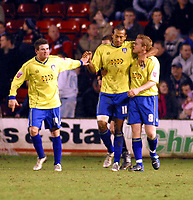 Photo: Dave Linney.<br />Walsall v Colchester United. Coca Cola League 1.<br />14/01/2006.<br />Colchester's Chris Iwelumo (C) celebrates his goal with   Gareth Williams.
