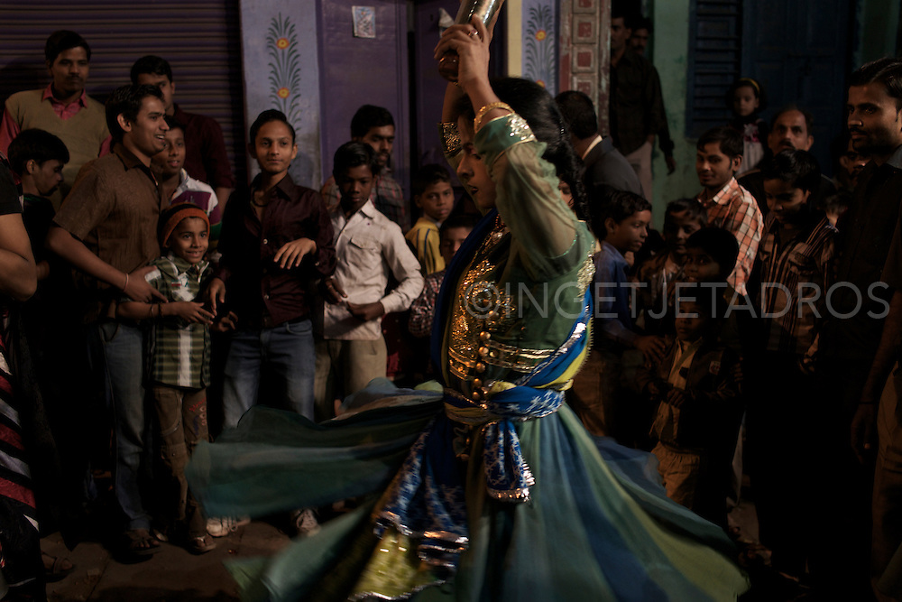 A Hijra, by starting a dance, opens the local Nakadia Festival. Varanasi, India.