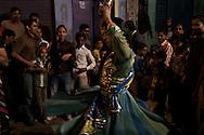 A Hijra, by starting a dance, opens the local Nakadia Festival. Varanasi, India.