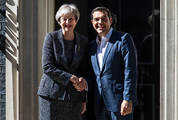 © Licensed to London News Pictures. 26/06/2018. London, UK. Prime Minister Theresa May (L) greets Prime Minister of Greece Alexis Tsipras (R) outside 10 Downing Street.  Photo credit: Rob Pinney/LNP