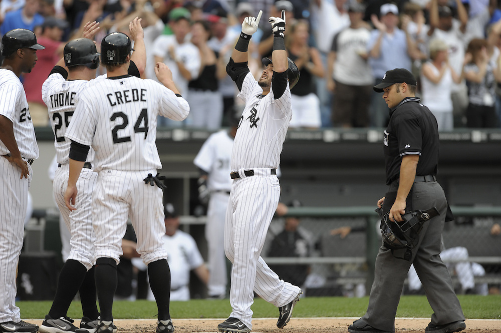 CHICAGO - JUNE 27:  Nick Swisher #30 of the Chicago White Sox is congratulated by teammates after hitting a grand slam home run off of Ryan Dempster during the game against the Chicago Cubs at U.S. Cellular Field in Chicago, Illinois on June 27, 2008.  The White Sox defeated the Cubs 10-3.  (Photo by Ron Vesely)