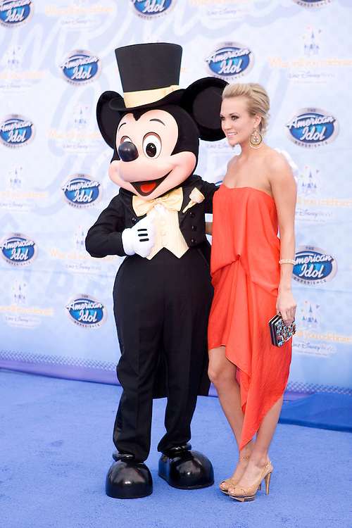 LAKE BUENA VISTA, FL - FEBRUARY 12: Carrie Underwood, season 4 winner, walks on the red carpet for the grand opening of the American Idol Experience at Disney's Hollywood Studios In Walt Disney World on February 12, 2009 in Lake Buena Vista, Florida. (Photo by Matt Stroshane/Getty Images)