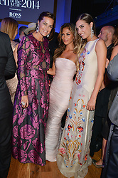 Left to right, YASMIN LE BON, NICOLE SCHERZINGER and AMBER LE BON at the GQ Men Of The Year 2014 Awards in association with Hugo Boss held at The Royal Opera House, London on 2nd September 2014.