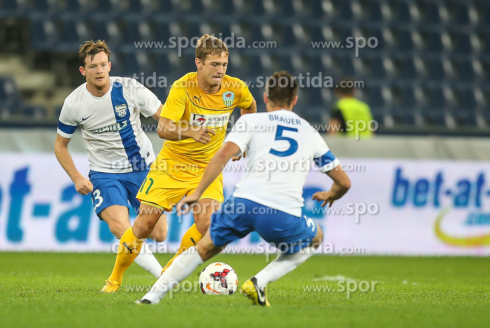 31.07.2014, Red Bull Arena, Salzburg AUT, UEFA EL Qualifikation, FC Groedig vs FC Zimbru Chisinau, dritte Runde, Hinspiel, im Bild Alexandru Dedov, (FC Zimbru Chisinau, #11) und Timo Brauer, (SV Scholz Groedig, #5) // during UEFA Europe League Qualifier first leg 3rd round between FC Groedig and FC Zimbru Chisinau at the Red Bull Arena in Salzburg, Austria on 2014/07/31. EXPA Pictures © 2014, PhotoCredit: EXPA/ Roland Hackl