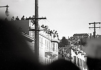 Students watching from rooftops  watching the Peoples Park Student protest & riots in Berkeley California 1969