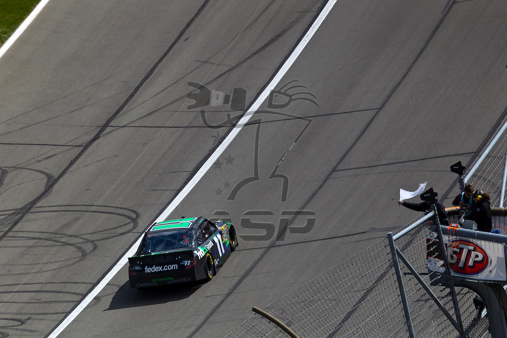 KANSAS CITY, KS - APR 22, 2012:  Denny Hamlin (11) holds off a hard charging field to win the STP 400 at the Kansas Speedway in Kansas City, KS.