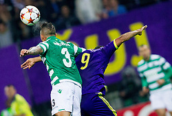 Maurício of Sporting vs Marcos Tavares of Maribor during football match between NK Maribor and Sporting Lisbon (POR) in Group G of Group Stage of UEFA Champions League 2014/15, on September 17, 2014 in Stadium Ljudski vrt, Maribor, Slovenia. Photo by Vid Ponikvar  / Sportida.com