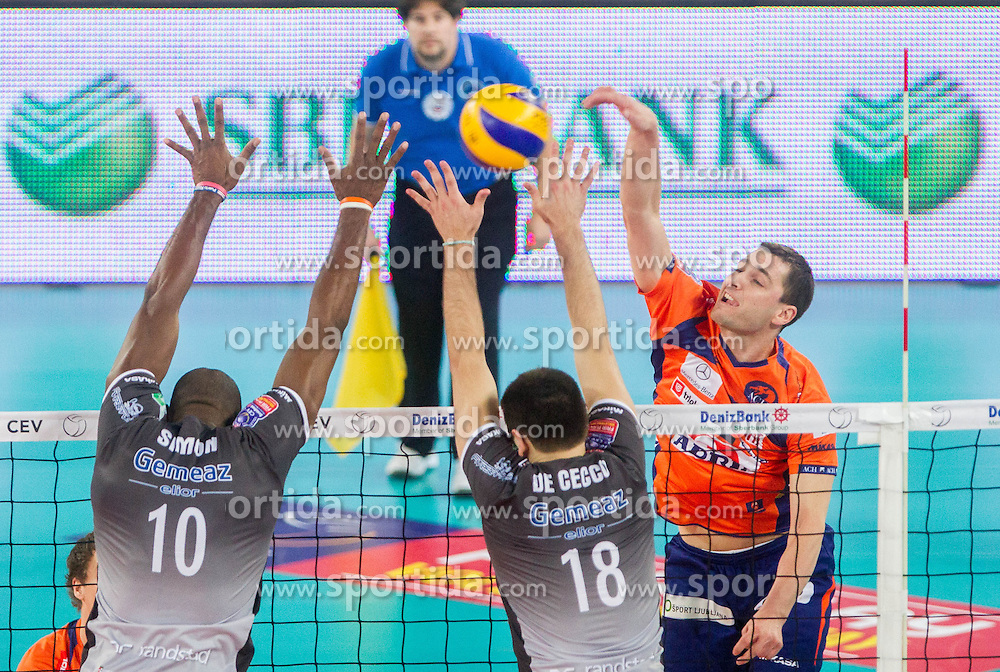 Simon Ateis and Luciano de Cecco of Piacenza vs Andrej Flajs of ACH during volleyball match between ACH Volley Ljubljana and Copra Elior Piacenza (ITA) in 6th Round of CEV Champions League 2013/14 on December 18, 2013 in Arena Stozice, Ljubljana, Slovenia.  Photo by Vid Ponikvar / Sportida