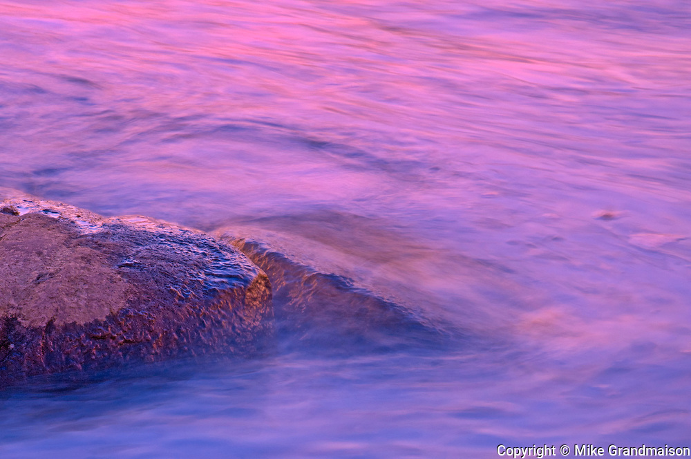 Rock and abstract at sunset. The flow of water narrows between Lovesick Lake and Lower Buckhorn Lake on the west and Stoney Lake to the east creating Burleigh Falls. Kawartha Lakes. <br />
