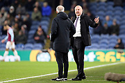 Burnley Manager Sean Dyche has words with Fourth official Martin Atkinson  during the Premier League match between Burnley and Manchester City at Turf Moor, Burnley, England on 3 December 2019.