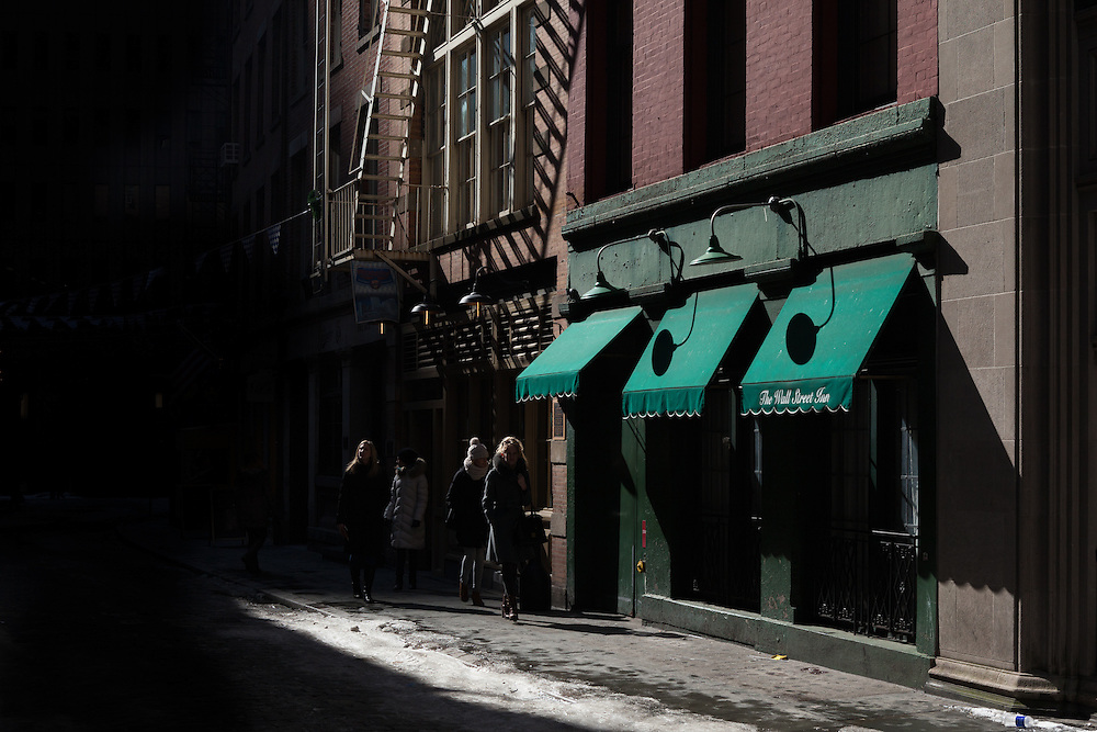 Emerging from the shadows, Stone Street, New York City
