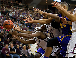 Texas A&M guard JJ Caldwell (4) and center Tonny Trocha-Morelos (10) fight LSU forward Wayde Sims (44) for a loose ball during the second half of an NCAA college basketball game Saturday, Jan. 6, 2018, in College Station, Texas. (AP Photo/Sam Craft)