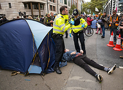 © Licensed to London News Pictures. 08/10/2019. City, UK. Extinction Rebellion sit-in at Westminster where up to two weeks of protest are planned. Police arrest protestors outside the Home Office. Photo credit: Alex Lentati/LNP