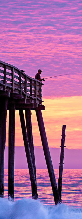 A silhouette of an incredible sunrise at Kitty Hawk pier.