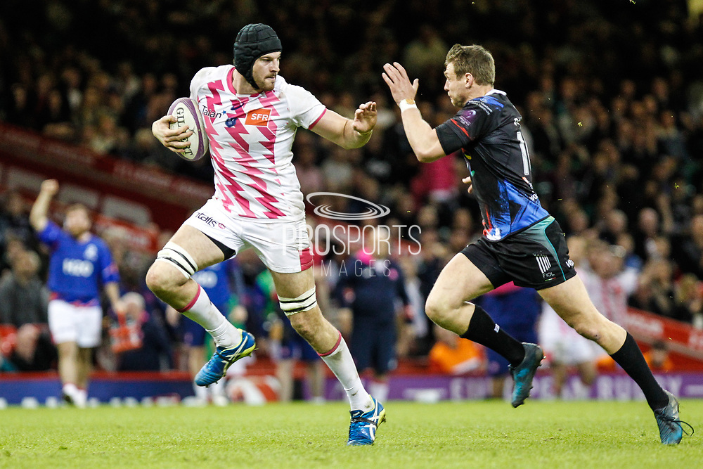 Stade Francais second row Hugh Pyle is chased by Ospreys outside half Dan Biggar during the European Challenge Cup match between Ospreys and Stade Francais at Principality Stadium, Cardiff, Wales on 2 April 2017. Photo by Andrew Lewis.