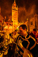 Waving a lantern of frankincense, The procession of the Brotherhood (Hermandad) San Benito, Holy Week (Semana Santa), Seville, Andalusia, Spain.