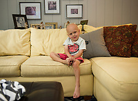 Max Gagnon welcomes us with a smile into his home in Laconia Monday morning.  (Karen Bobotas/for the Laconia Daily Sun)