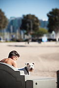 A Man and his Dog on a Bench at the Marina in Marina Del Rey California