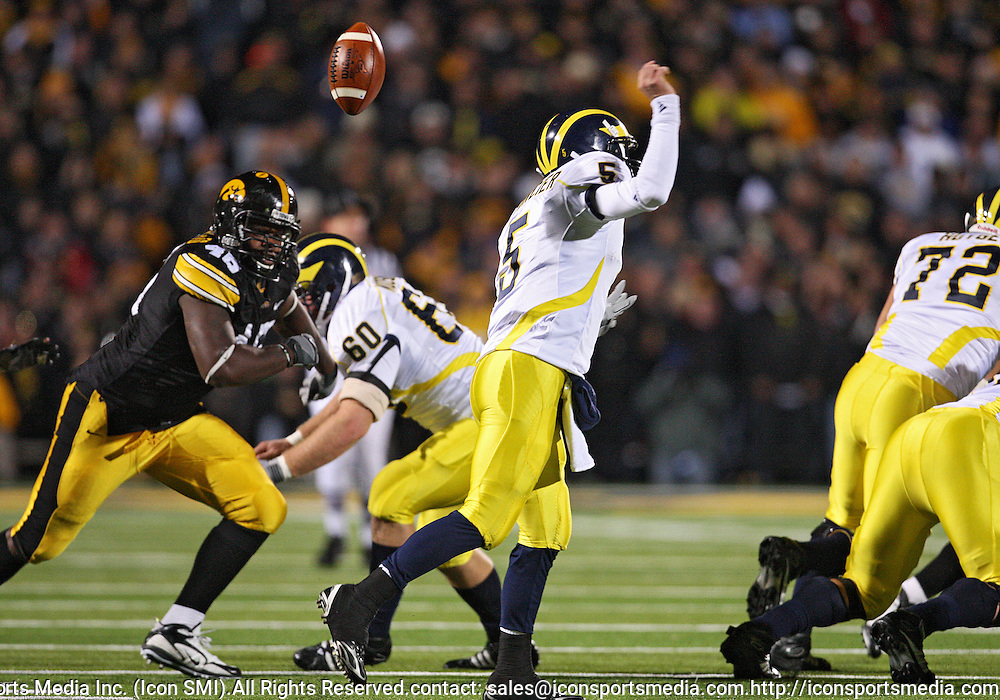 October 10, 2009: Michigan quarterback Tate Forcier (5) fumbles the ball during the first half of the Iowa Hawkeyes' 30-28 win over the Michigan Wolverine's at Kinnick Stadium in Iowa City, Iowa on October 10, 2009.