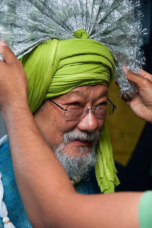 Dr David Suzuki, getting dressed in a Bhangra oufit for a photoshoot