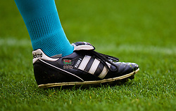ST HELENS, ENGLAND - Wednesday, October 24, 2018: The boot of assistant referee Ian Bird with a Wales flag during the UEFA Youth League Group C match between Liverpool FC and FK Crvena zvezda at Langtree Park. (Pic by David Rawcliffe/Propaganda)
