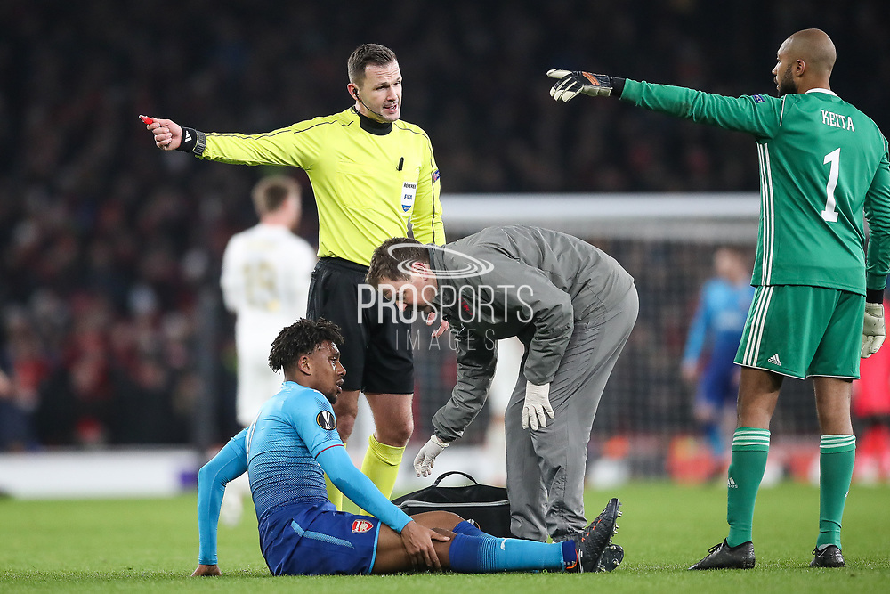 Arsenal physio Gary Lewin attends to Arsenal midfielder Alex Iwobi during the Europa League match between Arsenal and Ostersunds FK at the Emirates Stadium, London, England on 22 February 2018. Picture by Toyin Oshodi.