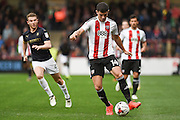 Brentford defender John Egan (14)   during the EFL Sky Bet Championship match between Brentford and Barnsley at Griffin Park, London, England on 22 October 2016. Photo by Martin Cole.
