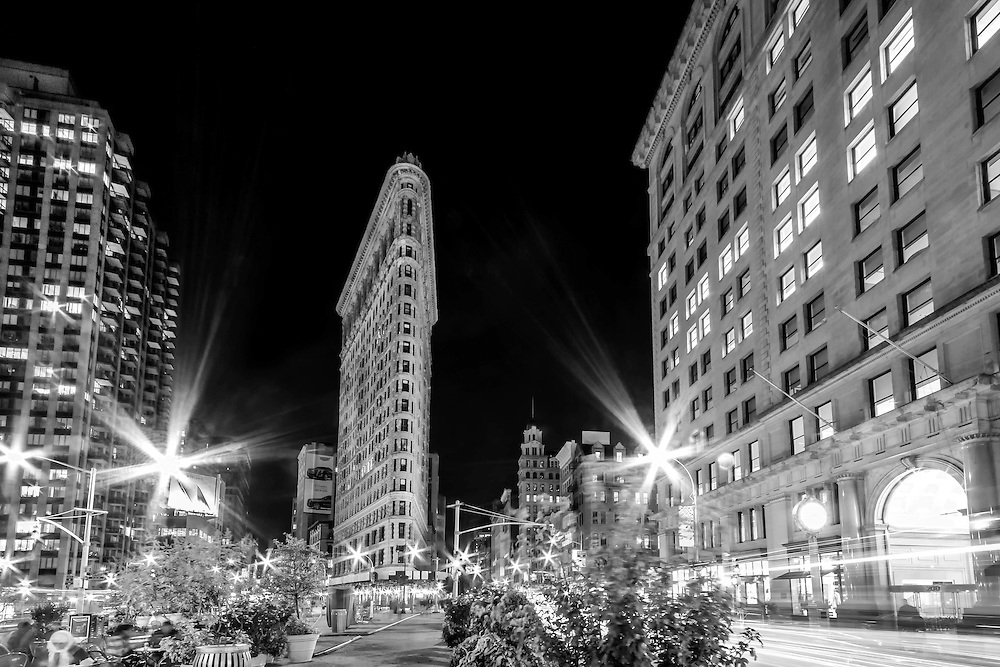 City lights illuminate the streets near the Flatiron Building in downtown New York City.