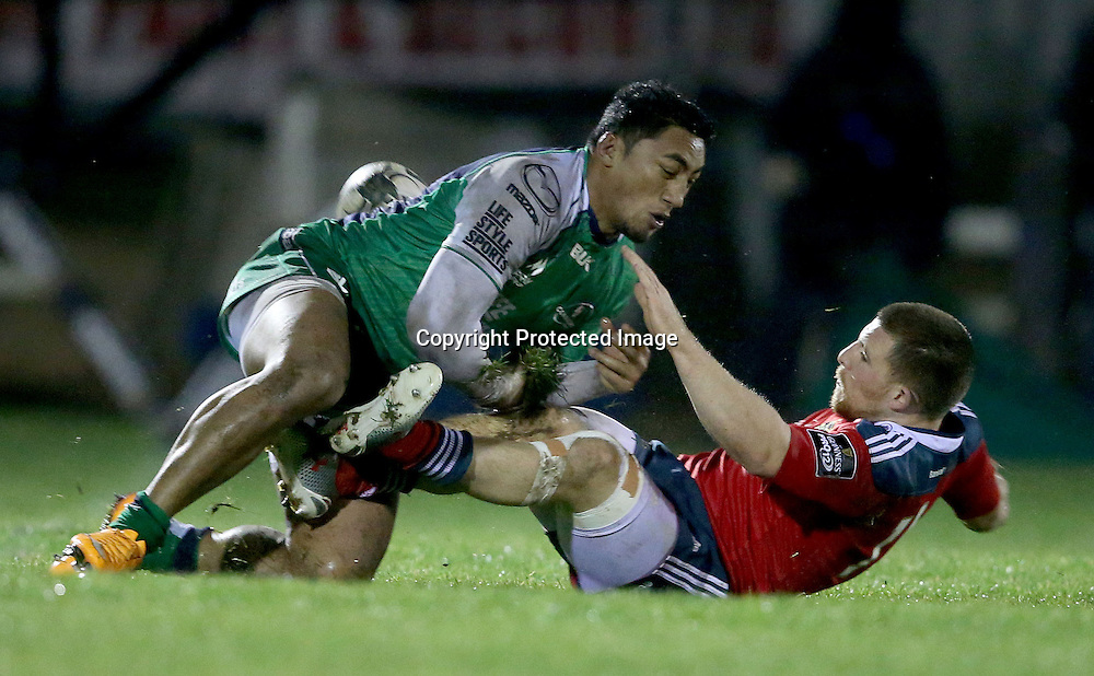 Guinness PRO12, Sportsground, Galway 1/1/2015<br /> Connacht vs Munster<br /> Connacht's Bundee Aki with Andrew Conway of Munster <br /> Mandatory Credit &copy;INPHO/Dan Sheridan