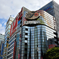 Sukiyabashi Crossing at Ginza in Tokyo, Japan<br /> Ginza is in the Chuo Ward. Its name means center of the city. At Harumi &amp; Sotobori Streets is one of its famous intersections: Sukiyabashi Crossing. This reflects when a stone bridge of the same name was built here in 1629 to span an outer moat of Edo Castle.