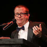 Sam Robison speaks Sunday March 8, 2015 during A Roast of John Staton, a benefit for Susan Auten at TheatreNOW in Wilmington, N.C. (Jason A. Frizzelle)
