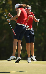 Austin Ernst of the United States (right) celebrates her birdie on No. 11 with playing partner Emily Tubert during the final round of the Spirit International, Saturday, November 5, 2011 at Whispering Pines Golf Club in Trinity, TX.