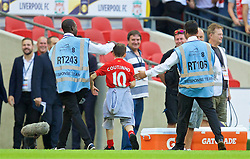 LONDON, ENGLAND - Saturday, August 6, 2016: A young Liverpool's supporter gives a steward the run-a-round after the 4-0 victory over FC Barcelona during the International Champions Cup match at Wembley Stadium. (Pic by David Rawcliffe/Propaganda)