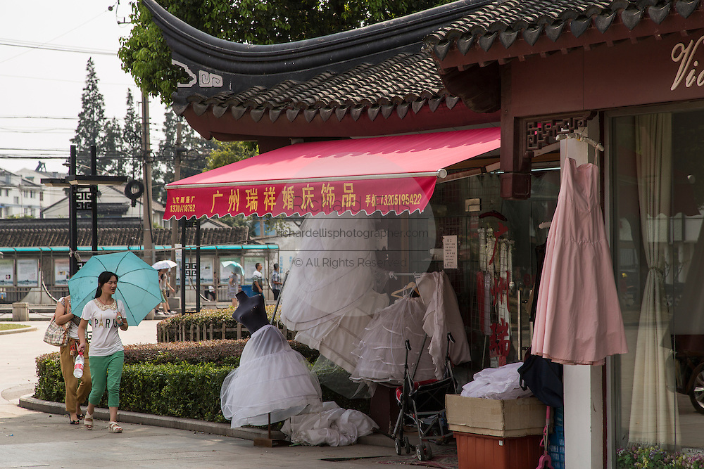 A shop selling western style wedding gowns in Suzhou, China. Suzhou is one of the largest producers of wedding dresses in the world.