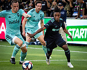 LAFC forward Latif Blessing (7) defends against Seattle Sounders forward Jordan Morris (13) during a MLS soccer match in Los Angeles, Sunday, April 21, 2019. LAFC defeated the Sounders 4-1. (Ed Ruvalcaba/Image of Sport)