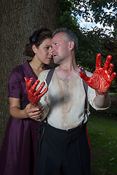 Pictured:   Bard in the Botanics . The latest production features a version of Macbeth set in 1950s, directed by Gordon Barr. Kirk Bage (Macbeth) and Nicole Cooper (Lady Macbeth) have blood on their hands as they perform the murder of Duncan scene on the main stage<br /> Karen Gordon  (c) Edinburgh Elite media Date<br />