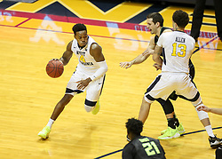 Jan 9, 2018; Morgantown, WV, USA; West Virginia Mountaineers guard Daxter Miles Jr. (4) dribbles the ball during the first half against the Baylor Bears at WVU Coliseum. Mandatory Credit: Ben Queen-USA TODAY Sports