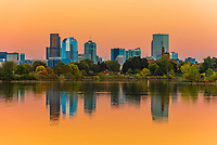 Sloans Lake at sunset with Downtown Denver in background, Colorado USA. Sloan's Lake is the biggest lake in Denver, and at 177 acres, it's the city's second largest park.