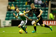 Hibernian forward Martin Boyle (#17) takes on Livingston defender Alan Lithgow (#4) during the Betfred Scottish Cup match between Hibernian and Livingston at Easter Road, Edinburgh, Scotland on 19 September 2017. Photo by Craig Doyle.