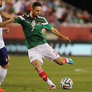 Miguel Layún, Mexico, shoots during the Portugal V Mexico International Friendly match in preparation for the 2014 FIFA World Cup in Brazil. Gillette Stadium, Boston (Foxborough), Massachusetts, USA. 6th June 2014. Photo Tim Clayton