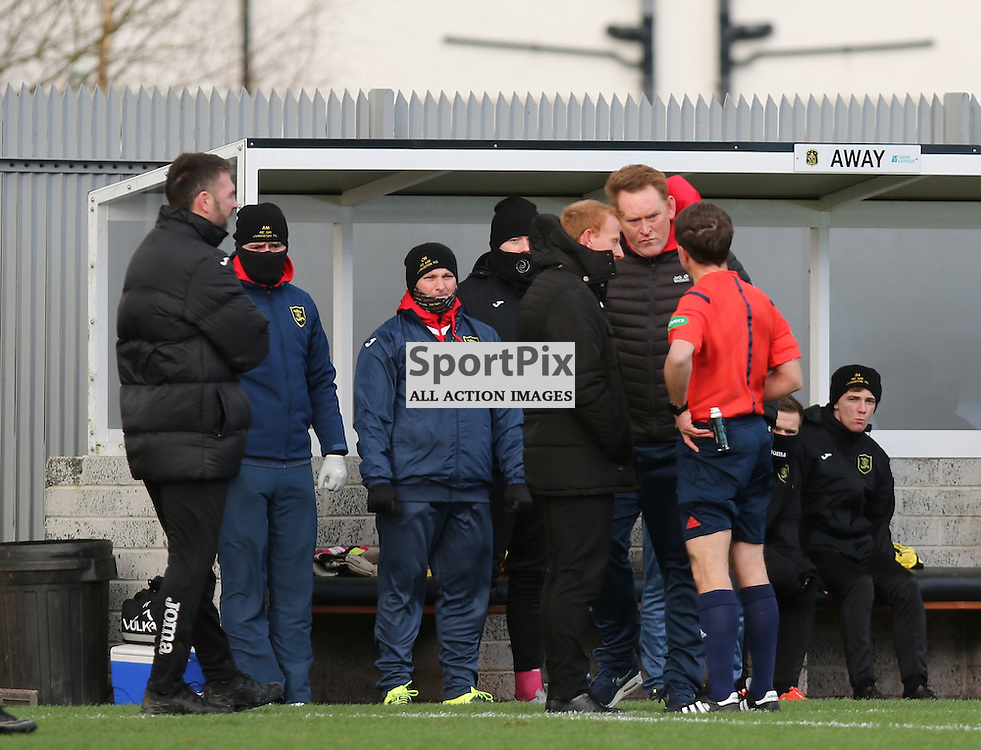 Ref Crawford Allen talks to both managers about the conditions at Dumbarton during the  Dumbarton v Livingston  Scottish Championship 30 January 2016<br /> <br /> (c) Andy Scott | SportPix.org.uk